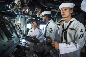 picture showing crewmen on a navy destroyer ship