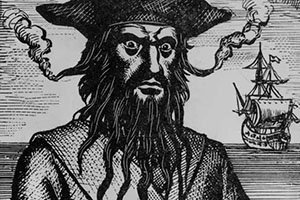 An ink drawing of the pirate Blackbeard with matches out of his ears