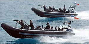 a photo of modern-day pirates, riding speedboats with guns on the bow of the boat