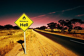 a sign on a road, with a fire icon saying welcome to hell