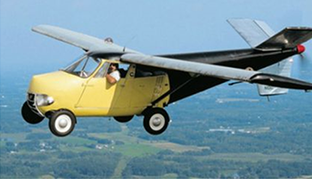 a photoshop of a car with airline wings attached and a propellor off the back