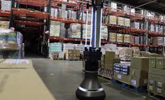 a photo of a robot warehouse worker sanitizing shelves