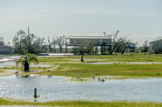 photo of a house on stilts in a flood plain